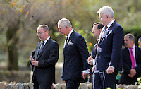 Pictured: Prince Charles joined by First Minister for Wales Carwyn Jones (R) at the Memorial Garden Friday 21 October 2016<br />