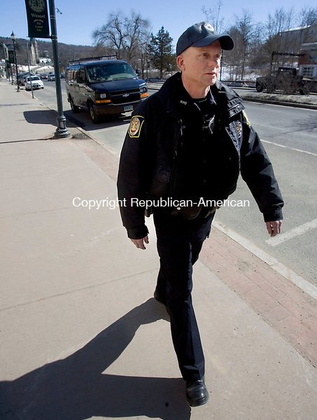 WINSTED CT. 06 March 2014-030614SV02-Officer Christopher Skinner heads out on foot patrol during his shift downtown Winsted Thursday.<br /> Steven Valenti Republican-American