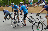 17 AUG 2014 - LONDON, GBR - A player from Sentinels (in light blue) tries to find a way to the Jackie Chan is Dead goal at the 2014 London Open Bike Polo tournament in Highbury Fields in London, Great Britain (PHOTO COPYRIGHT © 2014 NIGEL FARROW, ALL RIGHTS RESERVED)