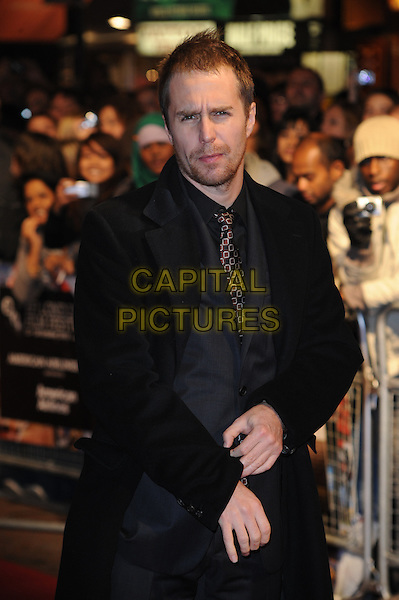"SAM ROCKWELL.The 54th BFI London Film Festival screening of ""Conviction"" at Vue cinema, Leicester Square, London, England, UK, October 15th 2010 .LFF half length black jacket grey gray suit tie coat hands beard facial hair stubble shirt .CAP/WIZ.© Wizard/Capital Pictures."