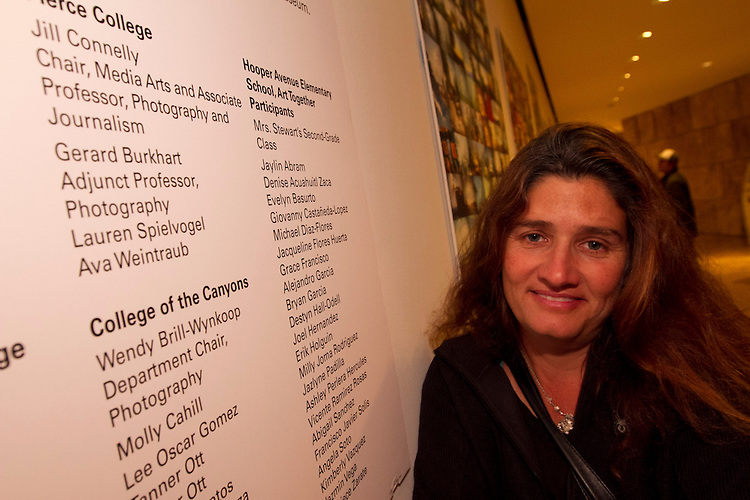 Pierce College Media Arts Chair Jill Connelly with poster from previous Getty Pierce collaboration during  a Student  Photography Installation during the Getty Museum's College Night in Los Angeles April 15, 2013..The students have been participating in an architectural photo class in conjunction with the Getty's Pacific Standard Time  Presents: Modern Architecture in L.A. along with three other Los Angeles area community colleges.. Photo: Gerard Burkhart...Gerard Burkhart Photo