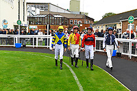 Jockeys share a joke as they enter the Parade Ring during Evening Racing at Salisbury Racecourse on 11th June 2019