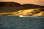 AZ, Arizona Lake Powell, near Grand Canyon National Park, scenic, power boat with Utah border in background, sunset .Photo Copyright: Lee Foster, lee@fostertravel.com, www.fostertravel.com, (510) 549-2202.Image: azlkpo210