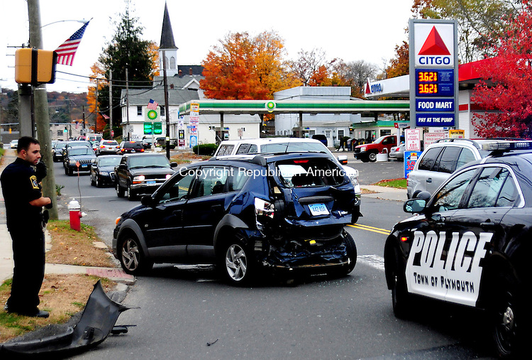 PLYMOUTH, CT, 24 OCT 12-102412AJ01- A Pontiac Vibe, rear ended by a tractor trailer at the intersection of Route 6 and 72 in Terryville at about 3:30 p.m. Wednesday snarled westbound traffic for more than an hour. Police said there were no injuries. The accident remained under investigation Wednesday evening. The tractor trailer, out of Bronx, N.Y., which hit the Pontiac was stopped in a parking lot behind the Plymouth Vol. Ambulance Corps for inspection by a State Police truck inspector. Alec Johnson/ Republican-American