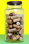 collection of various wine corks saved  in a glass bottle