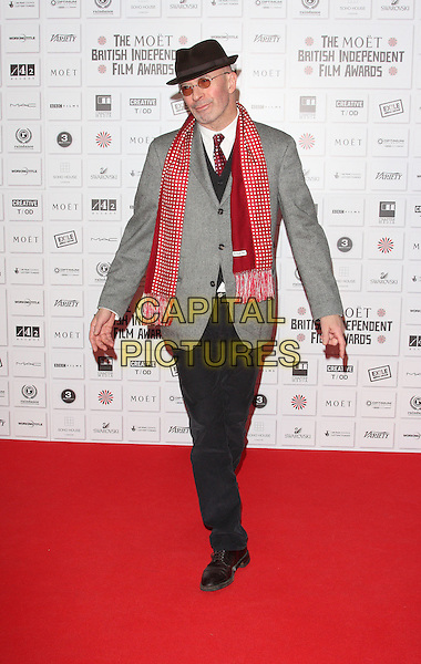 JACQUES  AUDIARD .Attending the Moet British Independent Film Awards 2010 held at Old Billingsgate, London, England, UK, December 5th 2010..full length hat glasses red tie scarf print white shirt back grey gray polka dot .CAP/ROS.©Steve Ross/Capital Pictures.