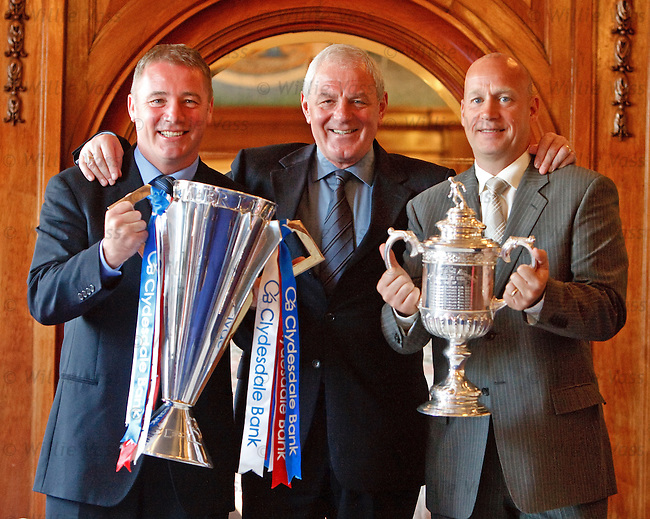 Walter Smith in the blue room at Ibrox with the SPL and Scottish Cup trophies after a double winning season for Rangers