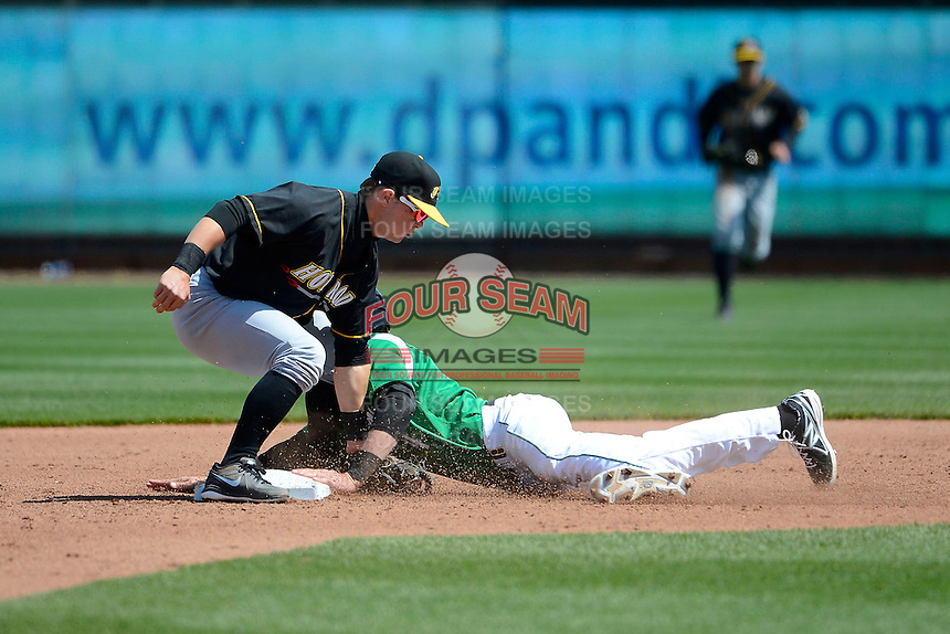 Bowling Green Hot Rods second baseman Tommy Coyle #6 tags out Zach Vincej #4 attempting to steal during a game against the Dayton Dragons on April 21, 2013 at Fifth Third Field in Dayton, Ohio.  Bowling Green defeated Dayton 7-5.  (Mike Janes/Four Seam Images)