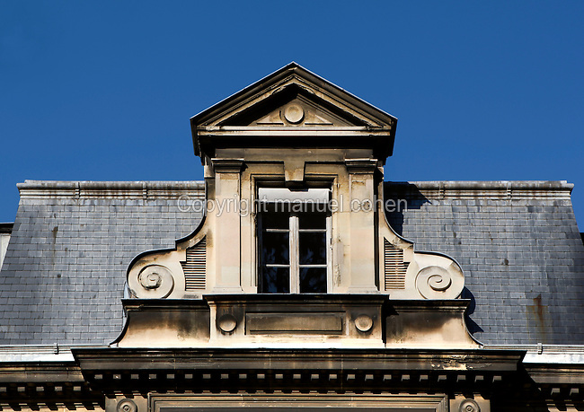 Detail of mansard roof with elaborate dormer window surrounds on the Hotel de Magny (formerly Pavillon Cuvier) which houses the Cabinet d'Histoire (History office), was built between 1696 and 1700 by Pierre Bullet and is located in the Jardin des Plantes, Paris, 5th arrondissement, France. Founded in 1626 by Guy de La Brosse, Louis XIII's physician, the Jardin des Plantes, originally known as the Jardin du Roi, opened to the public in 1640. It became the Museum National d'Histoire Naturelle in 1793 during the French Revolution. Picture by Manuel Cohen