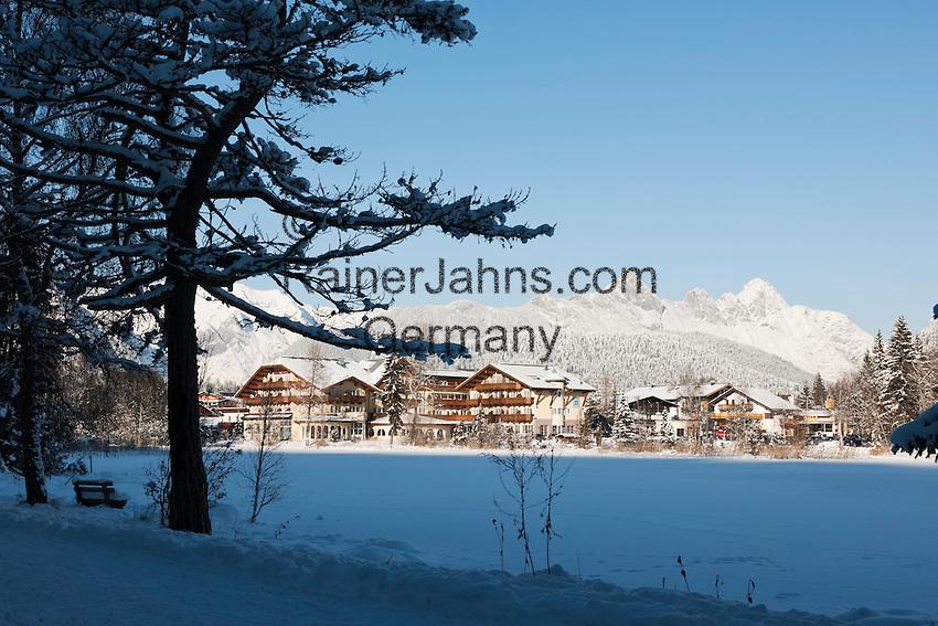 Austria, Tyrol, international Wintersport Resort Seefeld: frozen Wild Lake and Wetterstein mountains, Hotel Seespitz at background