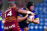 Picture by Alex Whitehead/SWpix.com - 08/02/2018 - Rugby League - Betfred Super League - Huddersfield Giants v Warrington Wolves - John Smith's Stadium, Huddersfield, England - Warrington's Chris Hill is tackled by Huddersfield's Dale Ferguson.