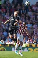 Stoke City's Jonathan Walters battles with Liverpool's Ragnar Klavan<br /> <br /> Photographer Terry Donnelly/CameraSport<br /> <br /> The Premier League - Stoke City v Liverpool - Saturday 8th April 2017 - bet365 Stadium - Stoke-on-Trent<br /> <br /> World Copyright &copy; 2017 CameraSport. All rights reserved. 43 Linden Ave. Countesthorpe. Leicester. England. LE8 5PG - Tel: +44 (0) 116 277 4147 - admin@camerasport.com - www.camerasport.com