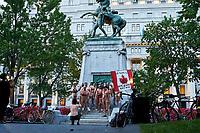Journee mondiale du velo nu,<br />  dans les rues de Montreal<br /> , le 18 juillet 2020.<br /> <br /> <br /> PHOTO :  Pierre Tran -<br /> Agence Quebec Presse