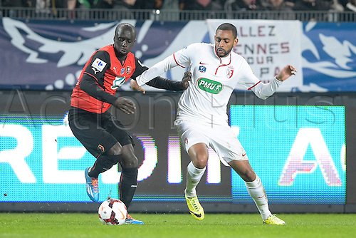 27.03.2014 Rennes, France. Cheikh Mbengue (Rennes) vs Ronny RODELIN (lille) in action during the Coupe de France quarter final match between Rennes and Lille. Rennes won the match 2-0.