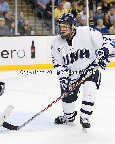 Damon Kipp (UNH - 4) - The Merrimack College Warriors defeated the University of New Hampshire Wildcats 4-1 in their Hockey East Semi-Final on Friday, March 18, 2011, at TD Garden in Boston, Massachusetts.