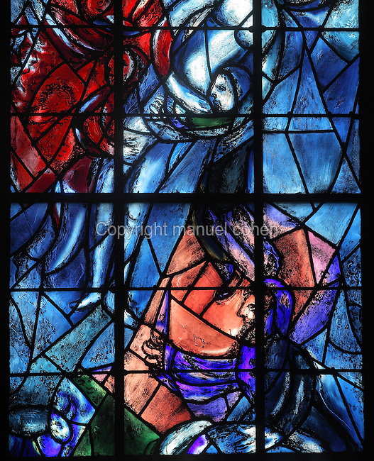 The sacrifice of Isaac, stained glass window, 1974, by Marc Chagall, 1887-1985, with the studio of Jacques Simon, in the axial chapel of the apse of the Cathedrale Notre-Dame de Reims or Reims Cathedral, Reims, Champagne-Ardenne, France. The cathedral was built 1211-75 in French Gothic style with work continuing into the 14th century, and was listed as a UNESCO World Heritage Site in 1991. Picture by Manuel Cohen