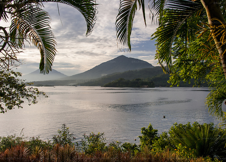 The volcanic terrain of North Sulawesi rises on the far side of the Lembeh Strait, viewed from the Lembeh Resort in late afternoon.