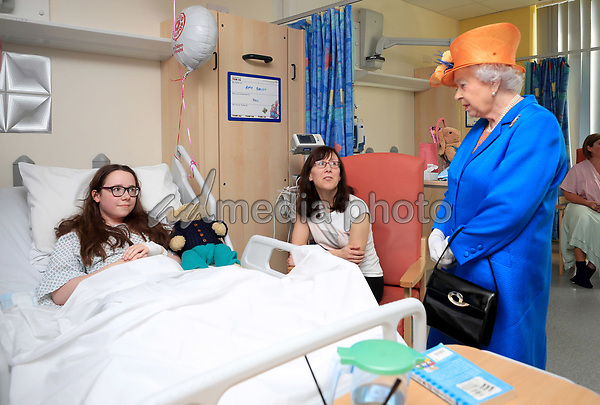 25 May 2017 - Queen Elizabeth II speaks to Amy Barlow, 12, from Rawtenstall, Lancashire, and her mother, Kathy, during a visit to the Royal Manchester Children's Hospital to meet victims of the terror attack in the city earlier this week and to thank members of staff who treated them. Photo Credit: ALPR/AdMedia