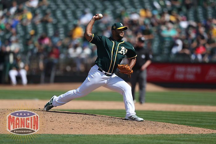OAKLAND, CA - AUGUST 15:  Yusmeiro Petit #36 of the Oakland Athletics pitches against the Seattle Mariners during the game at the Oakland Coliseum on Wednesday, August 15, 2018 in Oakland, California. (Photo by Brad Mangin)