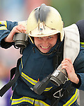 Vancouver, Canada, Aug 6th 2009.  World Police and Fire Games, Ultimate Firefighter Competition. Competitor Jan Seps from the Varnsdorf Fire Service, Czech Republic, exerts himself during the Hose Task portion of the competition.   Competitors must drag two 150-foot long 2 ½-inch fire hoses their full length plus 30 feet, and then move to another station and roll up two 50-foot sections of hose and carry them back to the finish line.  Photo by Gus Curtis