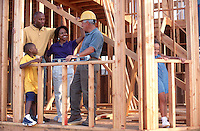 Family and builder during home construction