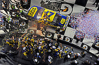 Winner Matt Kenseth (#17) climbs from his car in Victory Lane.