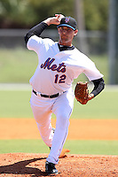 New York Mets minor league pitcher Jonathan Kountis #12 delivers a pitch during a spring training game vs the St. Louis Cardinals at the Roger Dean Complex in Jupiter, Florida;  March 24, 2011.  Photo By Mike Janes/Four Seam Images