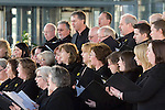 Welsh choir singing as the Welsh rugby team celebrate winning the Grand Slam in the Six Nations rugby tournament at The Senydd in Cardiff Bay..