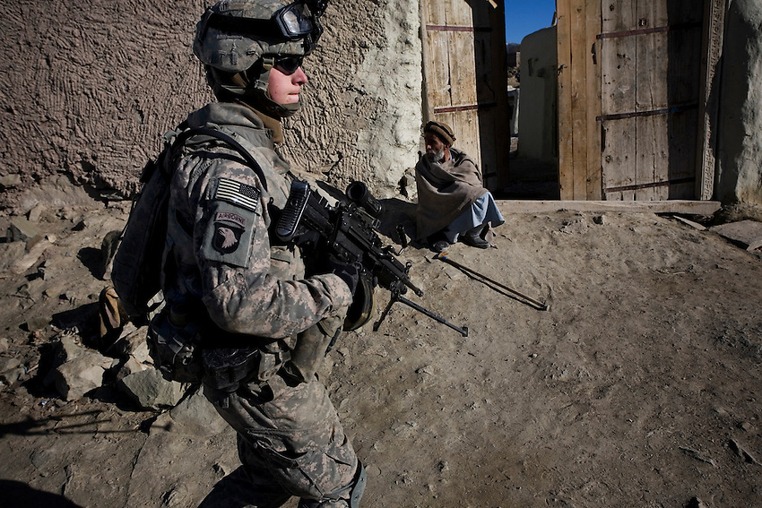 Members of Baker Company, 1/506th Infantry and Afghan security forces conduct a search operation in the village of Marzak, Paktika Province, Afghanistan, Thursday, Feb. 26, 2009.