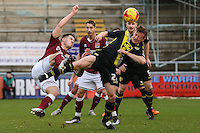 Marc Richards of Northampton Town beats Andy Parrish of Morecambe to the ball to gwet in a shot during the Sky Bet League 2 match between Northampton Town and Morecambe at Sixfields Stadium, Northampton, England on 23 January 2016. Photo by David Horn / PRiME Media Images.