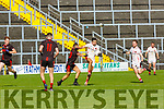 Rathmores Aidan O'Mahony goes past Mark Crowley Kenmare  during the SFC game in Fitzgerald Stadium on Sunday
