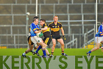 Seamus Moynihan Glenflesk holds onto the ball despite Keith McMahon Crokes tackle
