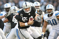 December 18, 2011 Oakland, CA: Oakland Raiders quarterback Carson Palmer #3 and Detroit Lions defensive end Kyle Vanden Bosch #93 during an NFL game played between the Oakland Raiders and the Detroit Lions at O.co Coliseum. The Lions defeated the Raiders 28-27.
