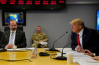 United States President Donald J. Trump attends a teleconference with governors at the Federal Emergency Management Agency headquarters, Thursday, March 19, 2020, in Washington, DC. United States Secretary of Health and Human Services (HHS) Alex Azar looks on from left.<br /> Credit: Evan Vucci / Pool via CNP/AdMedia