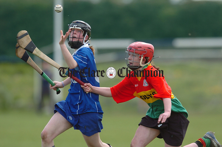 Scariff's Aisling Treacy beats her Castlecomer opponent to the ball during the All-Ireland colleges Junior B camogie final in Mountmellick. Photograph by John Kelly.