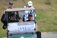 Graeme McDowell (NIR) takes the wheel during Wednesday's Pro-Am Day of the 2014 BMW Masters held at Lake Malaren, Shanghai, China 29th October 2014.<br /> Picture: Eoin Clarke www.golffile.ie
