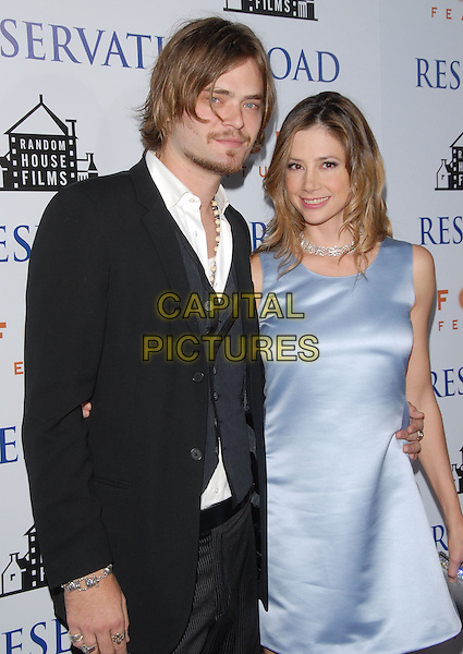 "CHRISTOPHER BACKUS & MIRA SORVINO.The L.A. Premiere of ""Reservation Road"" held at The Academy of Motion Picture Arts & Sciences in Beverly Hills, California on .October 18th, 2007.half length black suit jacket grey gray waistcoat blue satin silk dress married husband wife .CAP/DVS.©Debbie VanStory/Capital Pictures"