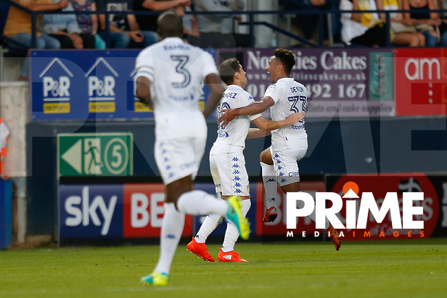 Tyler Denton of Leeds United (right) celebrates scoring the opening goal during the EFL Cup match between Luton Town and Leeds United at Kenilworth Road, Luton, England on 23 August 2016. Photo by David Horn.