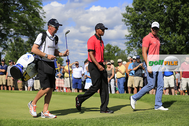 Henrik Stenson (SWE) and Tiger Woods (USA) walk off the 14th tee during Sunday's Final Round of the 2013 Bridgestone Invitational WGC tournament held at the Firestone Country Club, Akron, Ohio. 4th August 2013.<br /> Picture: Eoin Clarke www.golffile.ie