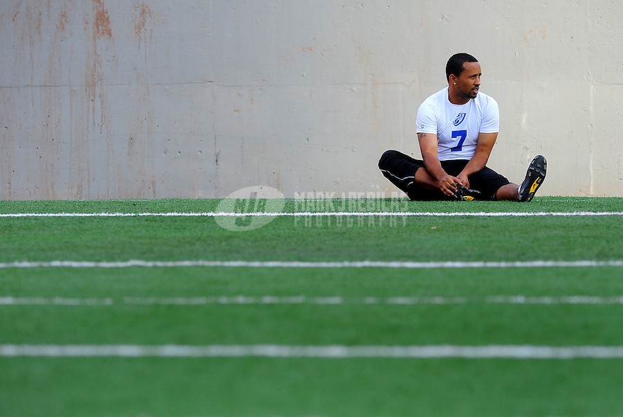 Jun. 13, 2009; Las Vegas, NV, USA; Justin McKinney stretches during the United Football League workout at Sam Boyd Stadium. Mandatory Credit: Mark J. Rebilas-