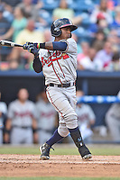 Rome Braves shortstop Ozzie Albies (7) swings at a pitch during a game against the Asheville Tourists on July 25, 2015 in Asheville, North Carolina. The Braves defeated the Tourists 3-2. (Tony Farlow/Four Seam Images)