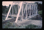 Engine crossing steel truss bridge.<br /> D&amp;RGW
