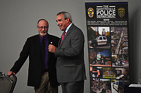 NWA Democrat-Gazette/J.T. WAMPLER Greg Tabor, Fayetteville police chief, (RIGHT) visits with mayor Lionel Jordan Wednesday Sept. 11, 2019 before Tabor's retirement ceremony at the Fayetteville Town Center. <br /> <br /> Tabor served 34 years in law enforcement, joining the Fayetteville Police Department in 1985. Tabor has termed out under the state's retirement system for law enforcement and firefighters, prompting his retirement this year. His last day at work will be Sept. 20. Deputy Chief Mike Reynolds is serving as interim chief until Mayor Lioneld Jordan names a successor.