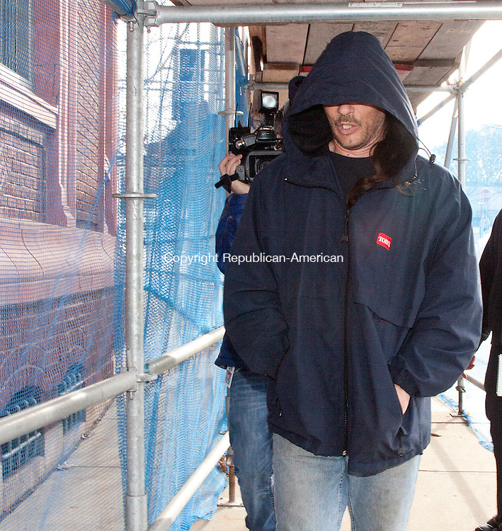 WATERBURY CT- DECEMBER 12  2012 -121212DA04- William Lampron, 43, of Naugatuck hides beneath his hood as camera crews follow him after his arraignment, outside the Waterbury Superior on Wednesday. Lampron a former city employee was charged with trying to poison his former boss with oatmeal laced with SpeedyDry..Darlene Douty Republican American