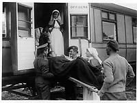 At the front<br /> Description<br /> <br /> Canadian Clearing Station - a jolly Canadian wounded officer leaves for England