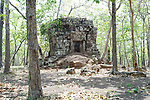 Angkorian temple Prasat at Koh Ker (early 10th century).<br /> Prasat grouped with Prasat Damrei<br /> Koh Ker temple complex is a remote archaeological site in the jungle of Preah Vihear province in northern Cambodia. Inscriptions found at the site say the name of the ancient town was Chok Gargyar. Briefly in the reign of Jayavarman IV and Harshavarman II (928–944 AD) it was the capital of the Khmer Empire.Koh Ker was also known as Lingapura (City of Lingams), all of the monuments here are dedicated to Hindu deities, mainly Shiva.