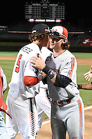 Brendan Rodgers (2) of Lake Mary High School in Longwood, Florida and Ryan Mountcastle (5) of Paul J. Hagerty High School in Winter Springs, Florida after the Under Armour All-American Game on August 16, 2014 at Wrigley Field in Chicago, Illinois.  (Mike Janes/Four Seam Images)
