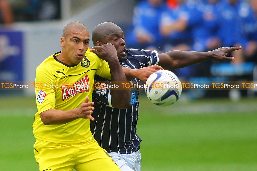 James Vaughan of Huddersfield Town and Danny Shittu of Millwall- Millwall vs Huddersfield Town - Sky Bet Championship Football at the New Den, South Bermondsey, London - 17/08/13 - MANDATORY CREDIT: George Phillipou/TGSPHOTO - Self billing applies where appropriate - 0845 094 6026 - contact@tgsphoto.co.uk - NO UNPAID USE