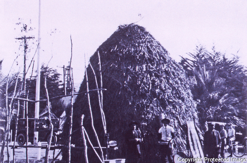 Tall structure, completed Chumash house, thatched with tules, Ventura County Fair, 1923.