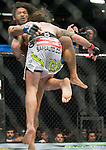 Benson Henderson is taken down by Clay Guida in a lightweight match during Saturday's UFC on Fox event.